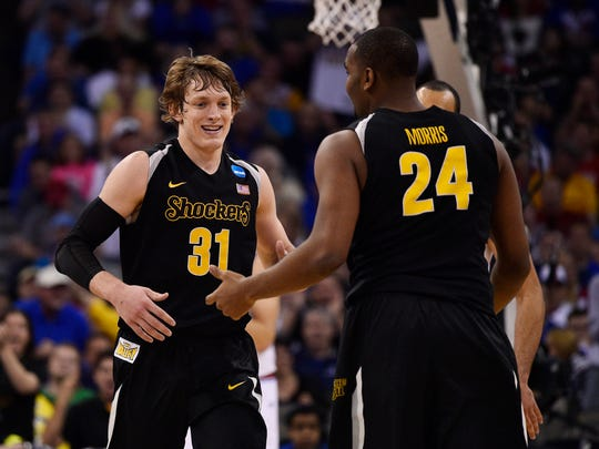 Wichita State guard Ron Baker (31) and forward Shaquille