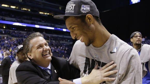 UK coach John Calipari, celebrates with Marcus Lee after Kentucky beat Michigan  in the 2014 NCAA Midwest Regional final.