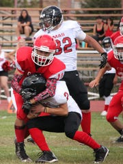 Cobre's Zack Sera makes this solo tackle during action Saturday against Mission Charter.