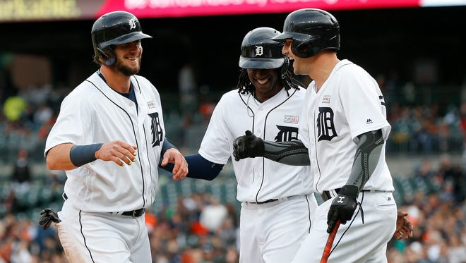 Detroit Tigers' Jarrod Saltalamacchia, from left, Cameron Maybin and Nick Castellanos celebrate after scoring on a Jose Iglesias three-run double against the Minnesota Twins in the first inning of a baseball game, Monday, May 16, 2016 in Detroit.