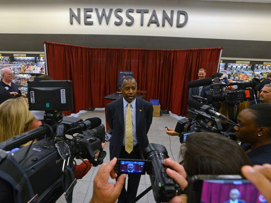 Presidential candidate Ben Carson speaks to the press
