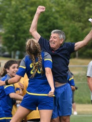 Head coach Barry Brodsky and Olivia Zardus celebrate.