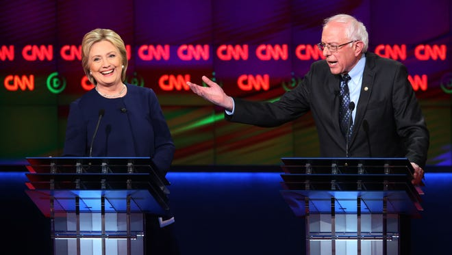 Bernie Sanders and Hillary Clinton speak during the CNN debate on March 6, 2016, in Flint, Mich.