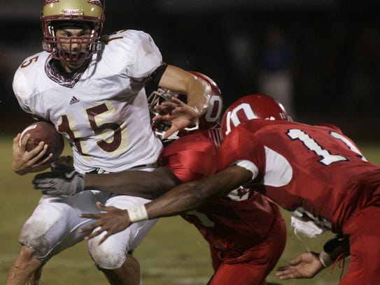 Riverdale quarterback Cody West gets tackled by Oakland