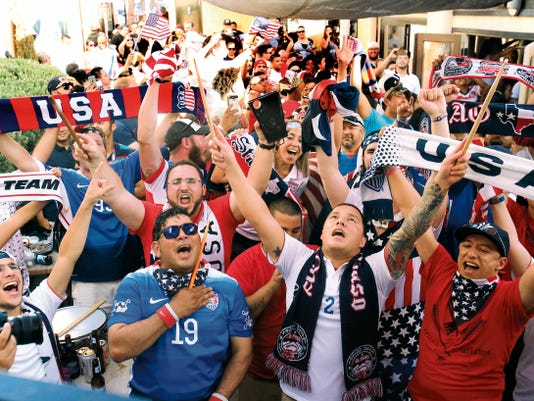 U.S. soccer fans watch the Woman's World Cup finals game with Japan at a viewing party at the Corner Tavern & Grille at 2700 N. Mesa Sunday.