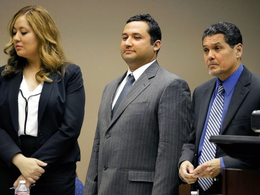 "Former Socorro city Rep. Jesus ""Jesse"" Gandara Jr. is flanked by his defense attorneys before breaking for lunch just after closing arguments were heard Wednesday in his bribery trial. He was convicted and faces between two and 20 years in prison and a fine."