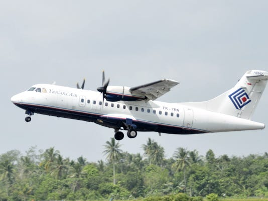 Trigana Air Service's ATR42-300 twin turboprop plane takes off Dec. 26, 2010, at Supadio airport in Pontianak, West Kalimantan, Indonesia. The same type of a Trigana airliner carrying 54 people was missing Sunday after losing contact with ground control during a short flight in bad weather in the country's mountainous easternmost province of Papua, officials said. A search for the plane was suspended and will resume Monday morning.