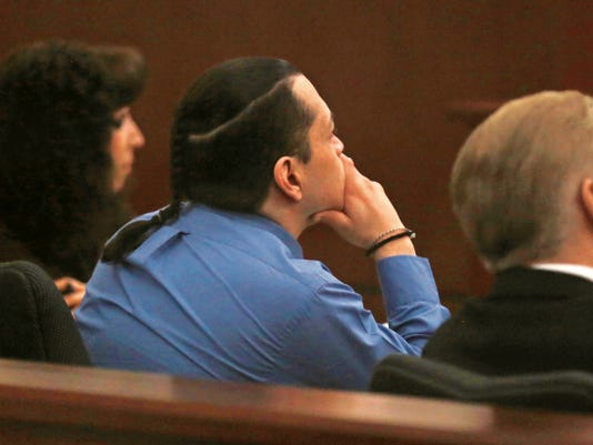 During his trial Tuesday at the Eleventh Judicial District Court in Aztec, Luis Ramirez watches dashboard camera video of when he and his brother, Alejandro Ramirez, were arrested in connection to the Animas Valley Mall murder in April 2013.