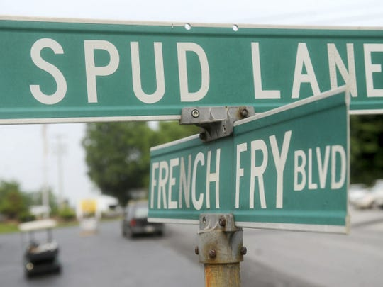 A crossroad sign outside of Bricker's French Fries in West Manchester Township plays off the love of fries.