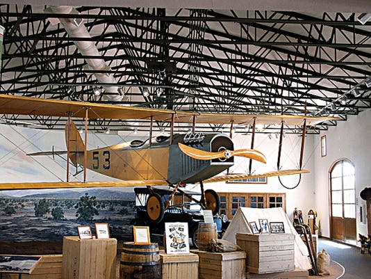 """A flying Jennie hangs above the Pancho Vllla State Park Exhibition Hall in Columbus, N. M. The Jennies were first used by the U.S. Army Air Service during the Punitive Expedition in the hunt for Mexican General Francisco """"Pancho"""" Villa."""