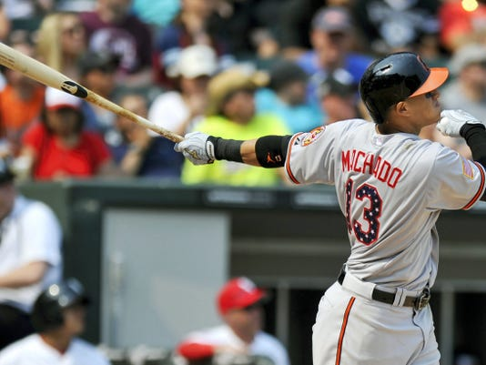 Baltimore Orioles' Manny Machado watches his two-run home run Saturday against the Chicago White Sox in Chicago.