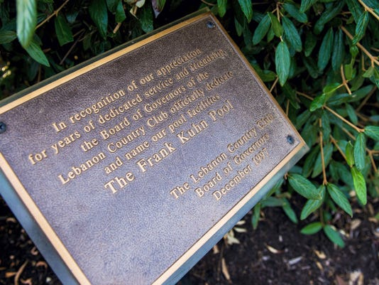"""A plaque outside of the Lebanon Country Club pool recognizes that the facility was named The Frank Kuhn Pool in 1997 in honor of Kuhn for his """"dedicated service and friendship."""""""