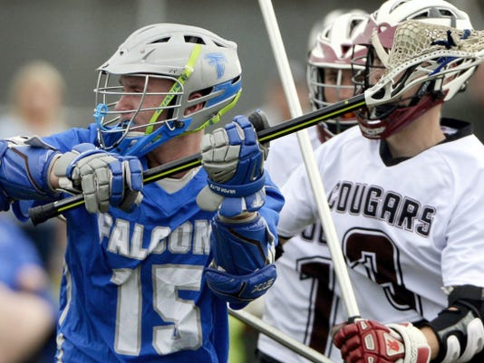 Austim Hummel of Cedar Crest rips a shot against Lancaster Country Day during the Falcons' 18-7 win on Tuesday.