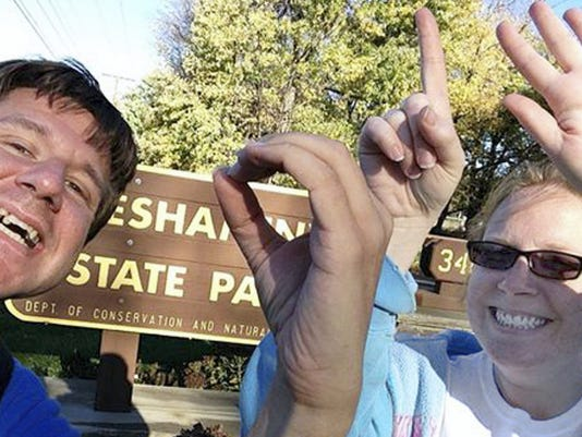 Kelly Fields of York City poses at Neshaminy State Park in Bucks County with friend Jon Gass of Enola last weekend.  Fields, 32, wants to visit all of Pennsylvania's 120 state parks. She's halfway there.