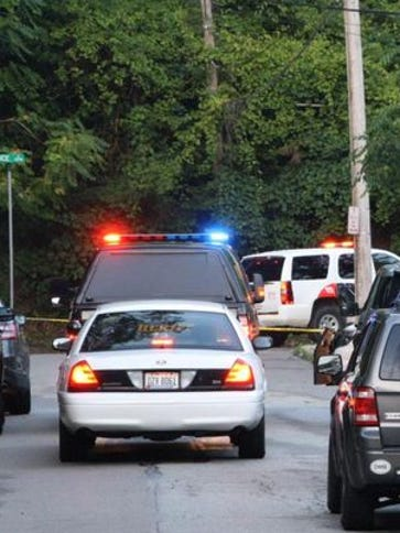 Police at a Mount Auburn intersection July 19 after