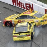 FILE - In this Nov. 1, 2015, file photo, Joey Logano (22) and Matt Kenseth (20) tangle in Turn 1 during the NASCAR Sprint Cup Series auto race at Martinsville Speedway in Martinsville, Va. It's the wild west in NASCAR right now, and it's not clear if that's good or bad for this championship battle. Drivers are doing whatever they have to do to make it to the finale, to mixed reactions.