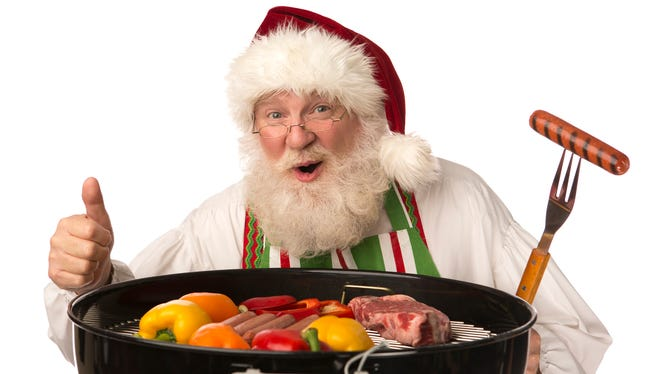 Santa Claus cooking and showing thumbs up