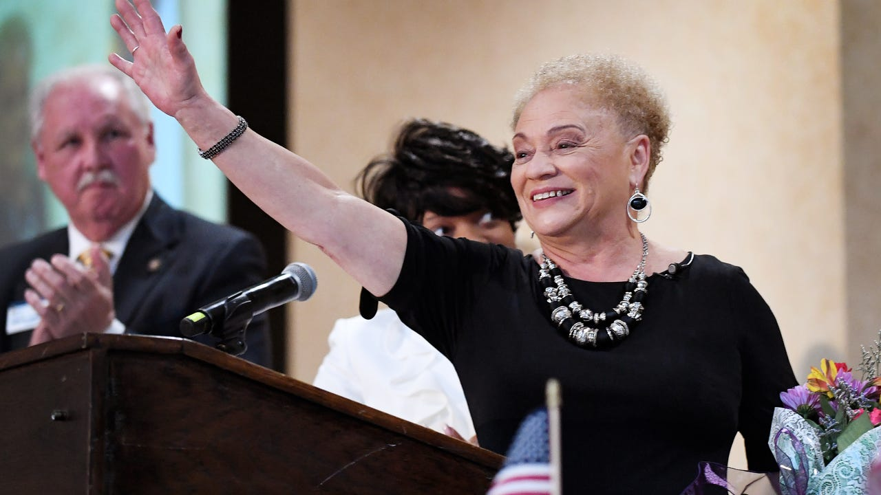 Oralene Simmons tells the story of how she discovered she was related to the descendants of the man who was the slave owner of her great-great grandfather, Joe Anderson, during the Martin Luther King Jr. Prayer Breakfast January 13, 2018.