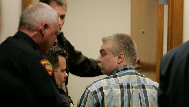 Steven Avery is escorted out of a courtroom in the Calumet County Courthouse in Chilton on March 18, 2007, the day he was found guilty of first-degree intentional homicide in the 2005 killing of photographer Teresa Halbach near the Avery family's auto salvage lot in rural Manitowoc County.