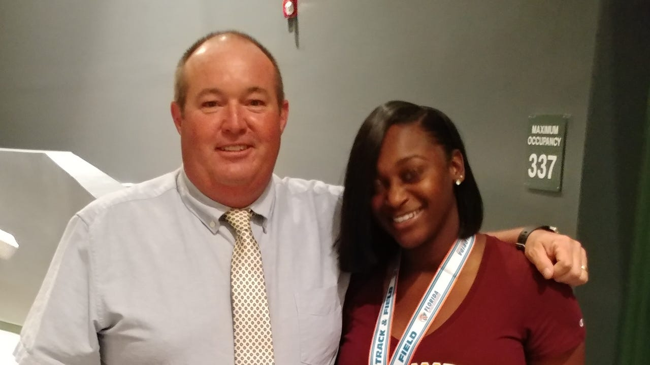 Island Coast senior thrower Precious Tillman holds a scholarship offer from Bethune-Cookman thanks in part to the shared commitment of her track coach for four years, Island Coast's Mitch Curliss.