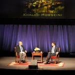 "Purdue University professor Kevin McNamara, left, interviews Khaled Hosseini, author of ""The Kite Runner,"" on Aug. 22, 2010, in Elliott Hall of Music. Hosseini's book was the one chosen that year for Purdue's Common Reading Program."