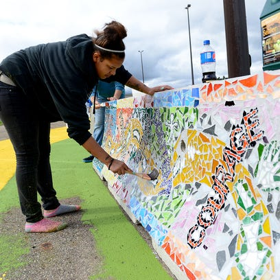 Marissa Nelson-Russell applies sealant to one of the