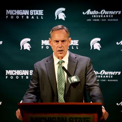 Head coach Mark Dantonio speaks to the media during