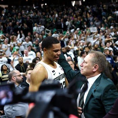 Michigan State head coach Tom Izzo, right, hugs Miles