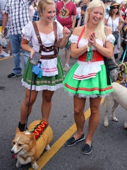Sisters Kathryn and Susan Bradley walk Luci in the Pup Parade during the 2017 Nashville Oktoberfest in Germantown.