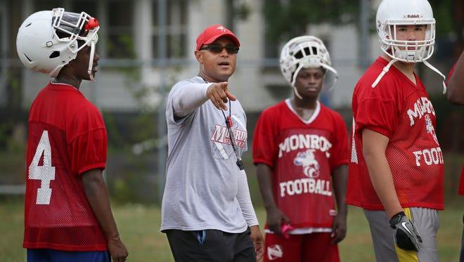 Monroe Head Coach Jason Muhammad guides his squad through punt formations.