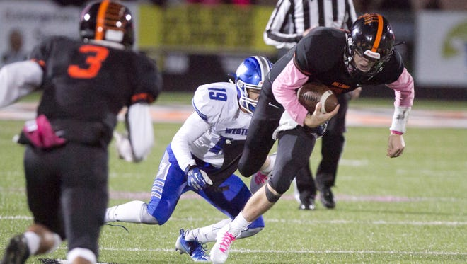 Brighton quarterback Will Jontz runs the ball against Walled Lake Western in the final KLAA Lakes Conference football championship on Oct. 21. The defection of Western and nine other schools will result in a new look to the KLAA.