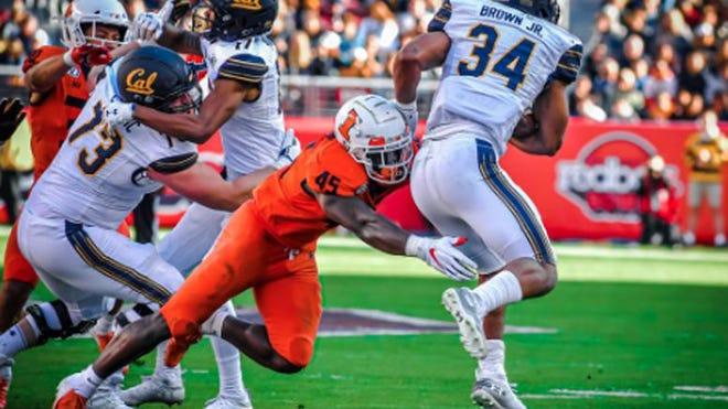 Illinois linebacker Khalan Tolson tackles California running back Christopher Brown Jr. on Dec. 30, 2019 in the Redbox Bowl at Levi's Stadium in Santa Clara, Calif.