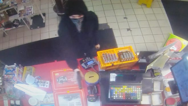 A gunman robbed the Shell gas station at 5890 National Road E. early Sunday morning.