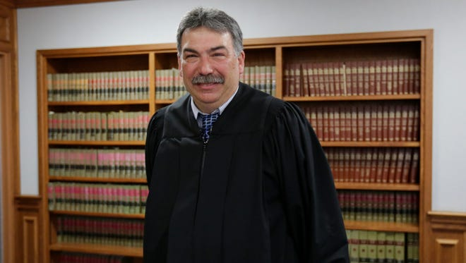 Judge Greg Grau poses for a photo Friday afternoon, May 20, 2016, at the Marathon County Circuit Courthouse in Wausau.