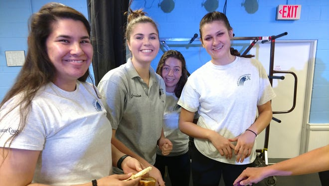 Students Nichole Shakoor, Jordan Ashley, Kate Ross and Maggie Gilenney enjoy a snack of 'eggs in a basket' during Martin Youth LEADERship's Health and Wellness Day.