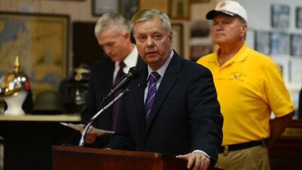 Sen. Lindsay Graham, right, and Rep. Trey Gowdy, left, speak to veterans at the Cecil D. Buchanan War Museum in Greenville last June. J