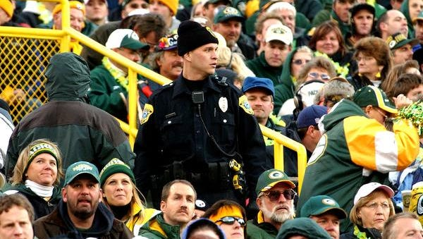 A Green Bay Police Department officer keeps an eye on the Lambeau Field crowd during the game against the Pittsburgh Steelers on Nov. 6, 2005.