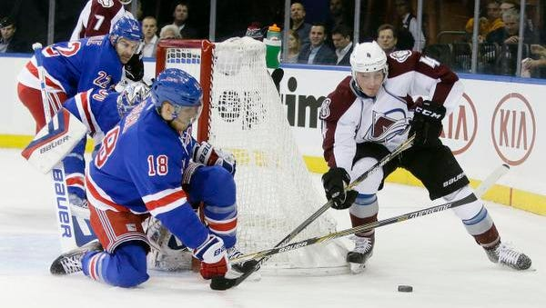 The Rangers' Marc Staal, left, defends the net as Colorado Avalanche defenseman Tyson Barrie looks for a scoring chance Thursday night at the Garden.