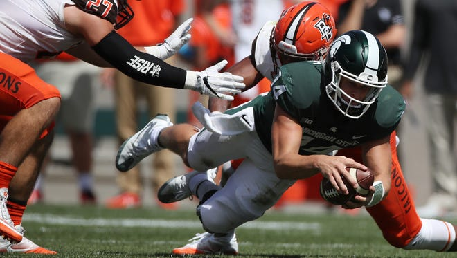 Michigan State quarterback Brian Lewerke dives for a first down against Bowling Green in the second half of the Spartans' 35-10 win Sept. 2, 2017 at Spartan Stadium.
