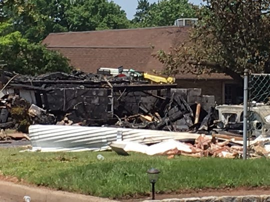 The remains of Hopkinson Avenue home in Piscataway that was destroyed by an explosion and fire Sunday.