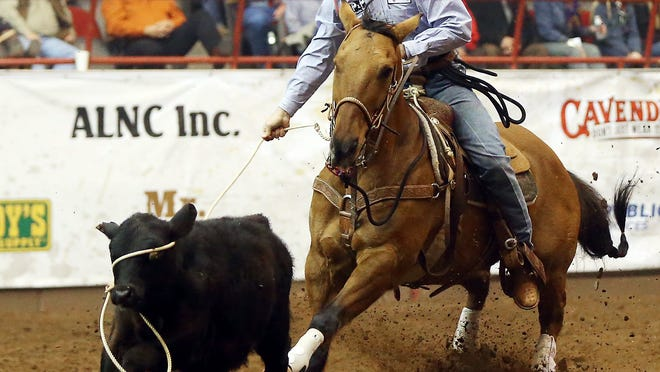 Cody Owens misses the head of the calf during the tie down roping competition during the 83rd San Angelo Stock Show & Rodeo at Foster Communications Coliseum in 2015. (Standard-Times file photo)
