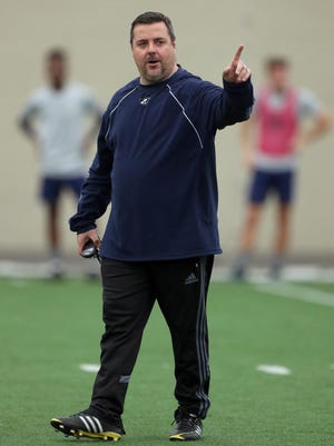University of Akron soccer coach Jared Embick will the lead the Zips back to the pitch after a 17-day COVID-19 delay against Northern Illinois on Sunday. [Phil Masturzo/Beacon Journal]