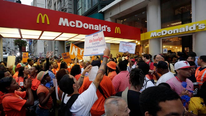 Protesting fast food workers demonstrate outside a McDonald's restaurant on New York's Fifth Avenue, on Thursday.