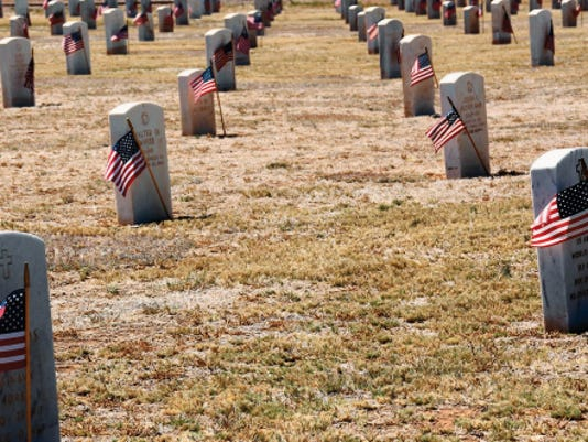 Vounteers placed flags on the veterans' graves at Fort Bayard National Cemetery in honor of Memorial Day. Mary Alice Murphy - Sun-News