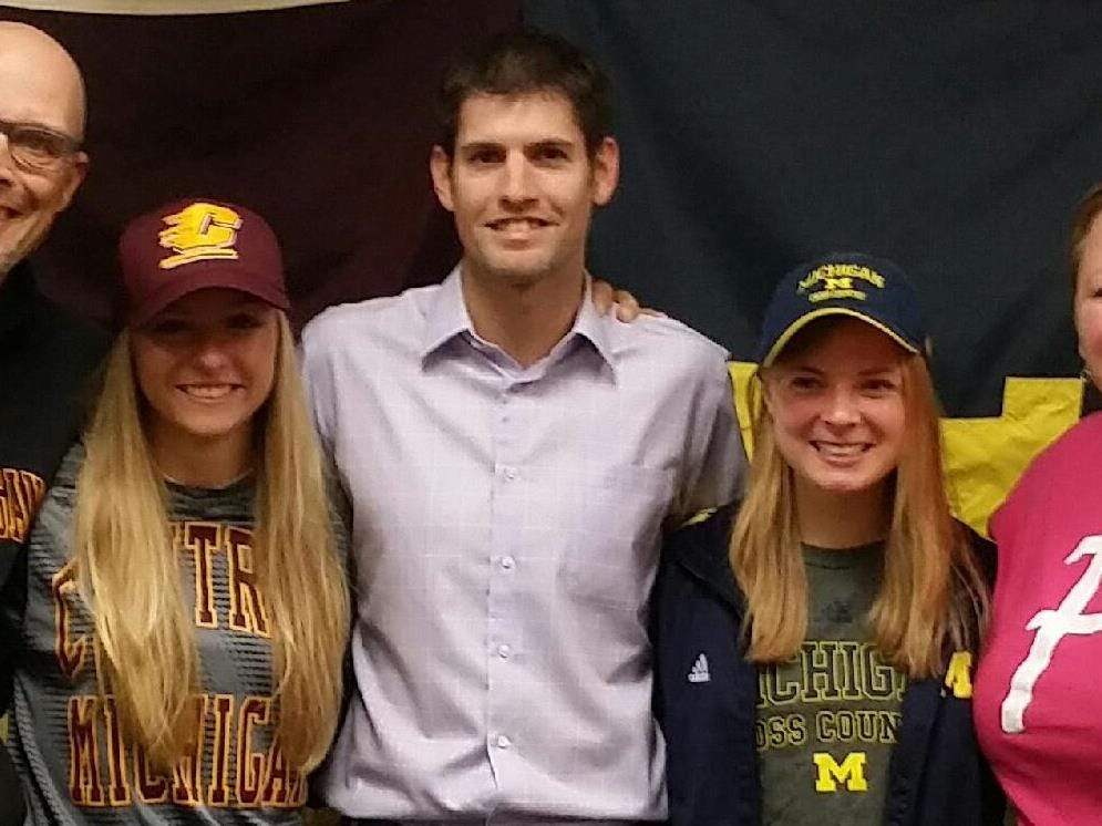 Farmington High School seniors Morgan Merlino and Maddy Trevisan signed letters of intent to compete in cross country and track at Central Michigan University and the University of Michigan, respectively. Pictured left to right are coach Charles Bridges, Merlino, coach Jeremy Auer, Trevisan and coach Kim Sturm.
