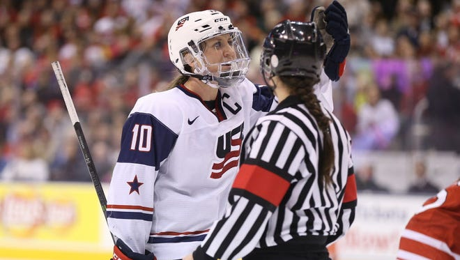 Meghan Duggan (10) talks with referee against Canada during a 2013 game. Negotiations between the USWNHT and USA Hockey regarding support and wages is ongoing.