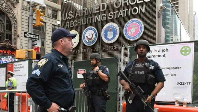 New York Police Department counterterrorism units patrol Times Square in New York on May 23, 2017, the morning after the Islamic State group claimed responsibility for a suicide bombing at a packed Manchester concert.