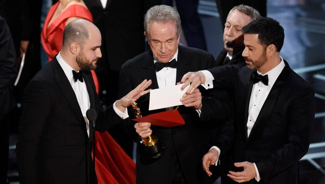 Warren Beatty puzzles over the Oscars best-picture envelope in 2017. The wrong winner was read, and the Academy's accounting firm promises changes this year.