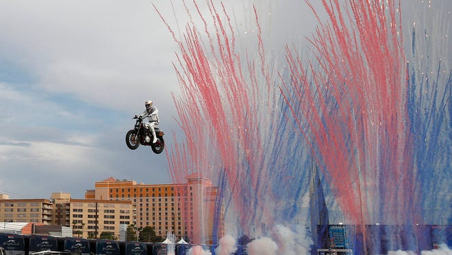 Travis Pastrana jumps a row of crushed cars on a motorcycle, Sunday, July 8, 2018, in Las Vegas.