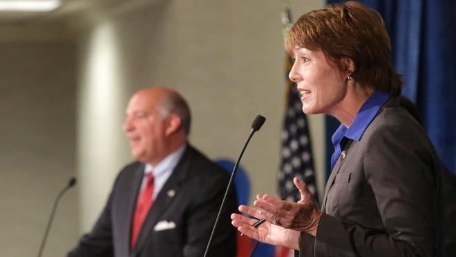 Democratic challenger Gwen Graham responds during a debate with GOP Rep. Steve Southerland at Florida State University on Oct. 15, 2014, in Tallahassee, Fla.